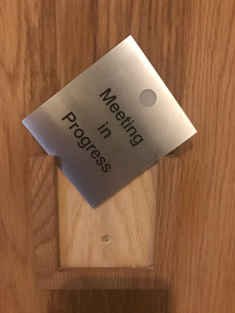 meeting in progress stainless steel plaques Oxford London